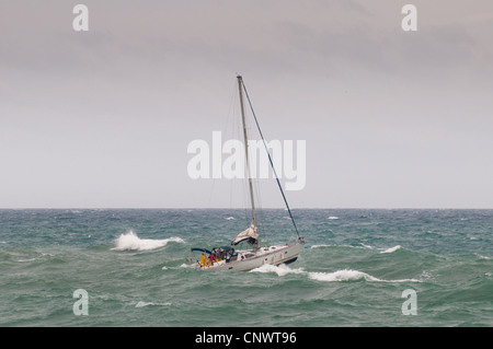 sailboat in stormy surge, France, Languedoc-Roussillon, S�te - Stock Photo