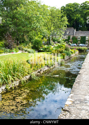 View to Bibury Trout Farm in the pretty English Cotswold village of Bibury in Gloucestershire England UK.Swan Hotel - Stock Photo