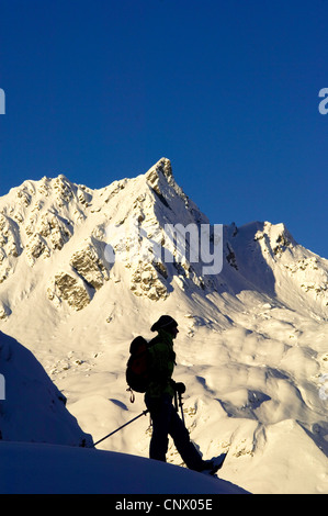 snow shoe hiker in north of Alps mountains, France, France - Stock Photo