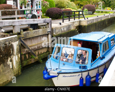 A motor cruiser passing through Buscot Lock, the smallest on the river Thames at Buscot Weir, Oxfordshire, England, - Stock Photo