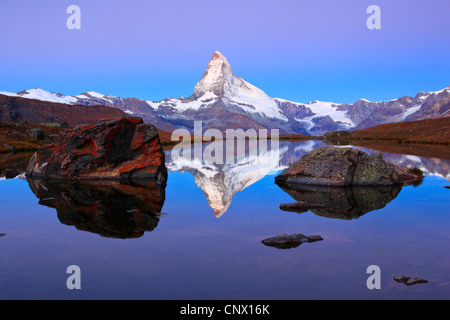 view at the Matterhorn from a mountain lake, Switzerland, Valais - Stock Photo