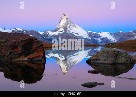view at the Matterhorn from a mountain lake, Switzerland, Valais - Stock Photo