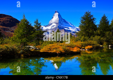 view from a mountain lake at the Matterhorn under clear blue sky, Switzerland, Valais - Stock Photo
