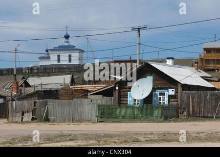 Orthodox church and a satellite dish in Khuzhir Village on Olkhon Island on Lake Baikal, Siberia, Russia. - Stock Photo