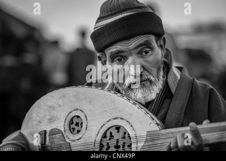 A portrait of an elderly musician playing in Marrakesh, Morocco - Stock Photo