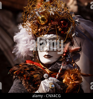 A woman dressed up for the Carnival in Venice, Veneto, Italy - Stock Photo