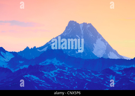 view from the Nufenen Pass at the Finsteraarhorn (4274 m) lying in shadow in front of red evening sky, Switzerland, - Stock Photo