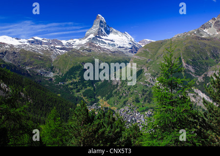 summer view from forested mountain slope over village Zermatt at the Matterhorn, Switzerland, Valais