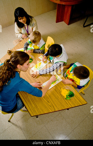 Teachers watch as blind children use yellow and green gel to signify lemon and lime -- both starting with the letter - Stock Photo