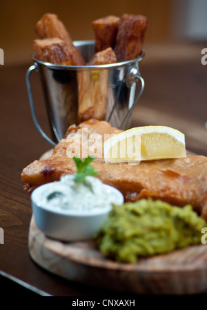 Picture by Darren Cool  Fish and Chips with mushy peas and tartar sauce, served in pub Hove Place, Hove, Sussex, - Stock Photo