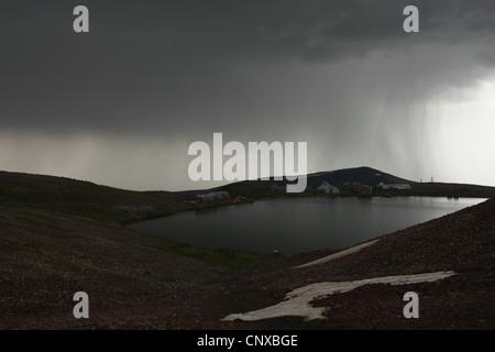 Heavy rain over Lake Kari (3,190 m) on the slopes of Mount Aragats in Aragatsotn province, Armenia. - Stock Photo