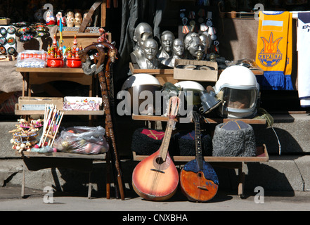 Souvenir stalls in Andriyivskyy Descent in Kiev, Ukraine. Ukrainian folk music instrument kobza is seen in the foreground. - Stock Photo