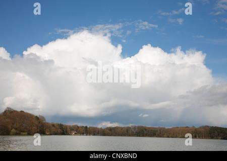 Cumulonimbus shower cloud over Talkin Tarn near Carlisle, Cumbria, Endland UK. - Stock Photo