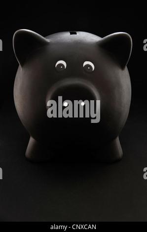 Black Piggy Bank on a black background - Stock Photo