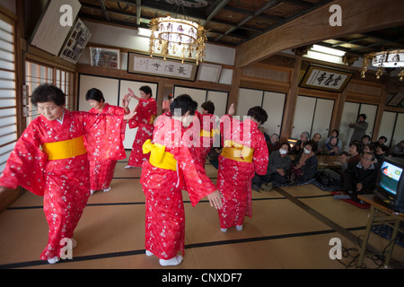 Elderly residents of Minami-Soma town enjoy a show to help them cope with stress, post March2011 tsunami disaster, - Stock Photo