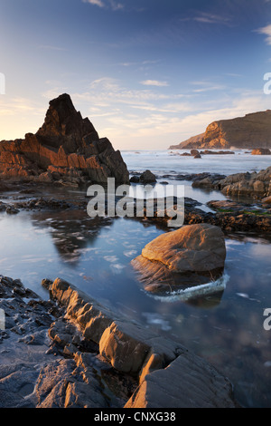 Rockpools and jagged rocks at Duckpool beach in North Cornwall, England. Spring (March) 2011. - Stock Photo