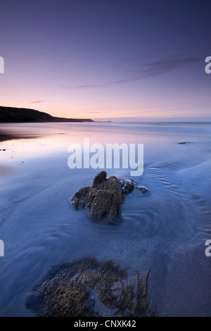 Dawn over the beach at Kennack Sands on the Lizard Peninsula, Cornwall, England. Spring (May) 2011. - Stock Photo