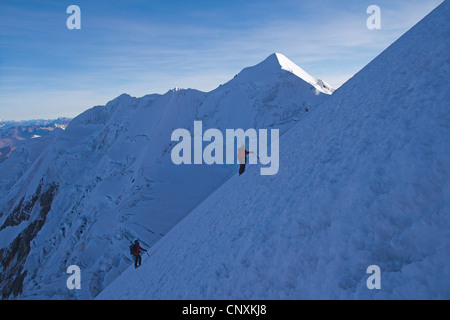 mountaineers climbing to the Illimani peak, Bolivia, Andes, Cordillera Real - Stock Photo