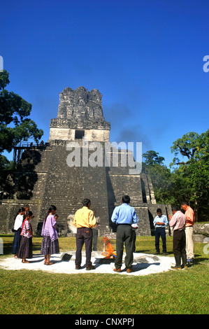 group of peole at a shamanic rite at the main square in front of the pyramid at the main square of the Maya city - Stock Photo