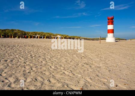 lighthouse on sand beach, Germany, Schleswig-Holstein, Helgoland-Duene - Stock Photo