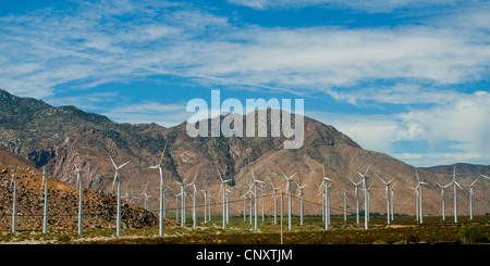 wind wheels in front of mountains along Interstate 10, USA, California - Stock Photo