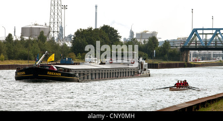 cargo ship and oarsmen on the Wesel-Datteln Canal at the coal harbour Auguste Victoria, Germany, North Rhine-Westphalia, - Stock Photo