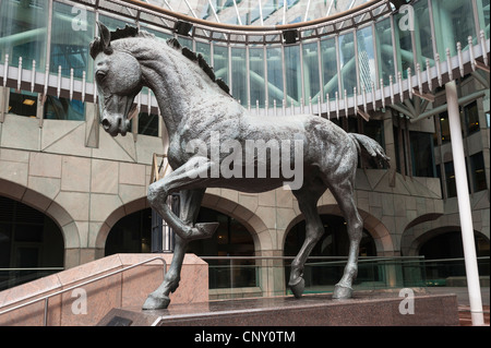 City of London Minster Court statue one of 3 mincing horses by Althea Wynne by this postmodern-gothic office block - Stock Photo