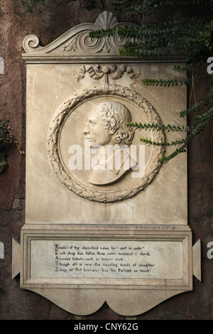 Commemorative plaque to English Romantic poet John Keats beside his grave at the Protestant Cemetery in Rome, Italy. - Stock Photo