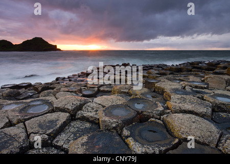 Sunset over the Giants Causeway, County Antrim, Northern Ireland - Stock Photo