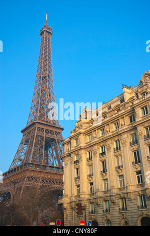 Eiffel Tower and residential building seen from Quai Branly - Stock Photo