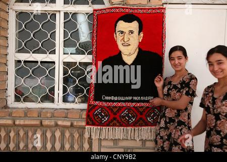 Carpet weaving workshop produced carpets with customers' photographs in Khiva, Uzbekistan. - Stock Photo