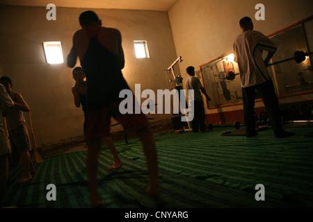 Uzbek athletes working out in a gym in Khiva, Uzbekistan. - Stock Photo