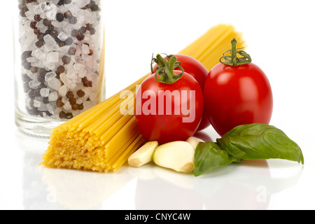 Spaghetti pasta with tomatoes, basil and garlic on a white background - Stock Photo