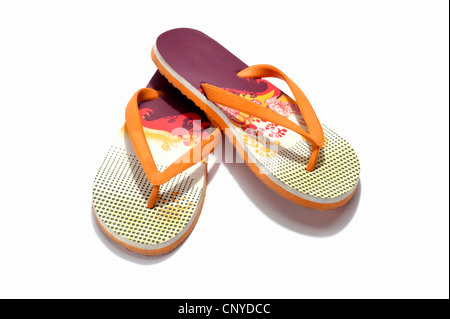 A pair of orange and red flip flops - Stock Photo