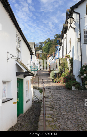View up the steep narrow cobbled street in quaint village of Clovelly, North Devon, England, UK, Britain. - Stock Photo