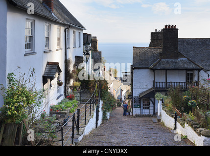 View to the sea down steep narrow cobbled street in quaint old village of Clovelly, North Devon, England, UK, Britain - Stock Photo