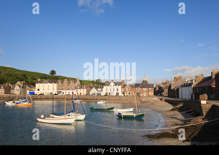 View across former iron age fishing port with boats in harbour at Stonehaven, Aberdeenshire, Scotland, UK. - Stock Photo