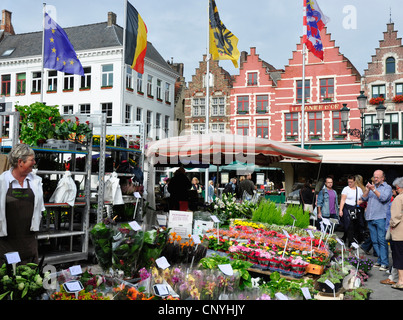 Belgium - Bruges - Market Square - colourful flowers fruit and vegetable stalls - bright sunlight - blue sky - Stock Photo