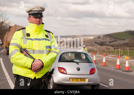 Traffic police officers operating a speed trap - Stock Photo