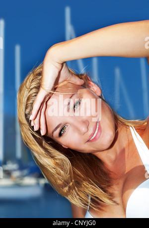Woman enjoying sailing trip, close-up portrait on happy smiling female face, summer cruise holidays, European girl - Stock Photo