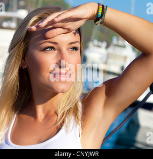 Close-up portrait on happy smiling female face, summer cruise holidays, European girl tourist traveling in sail - Stock Photo