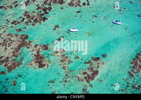 two little boats in turquoise water of Indian Ocean - Stock Photo