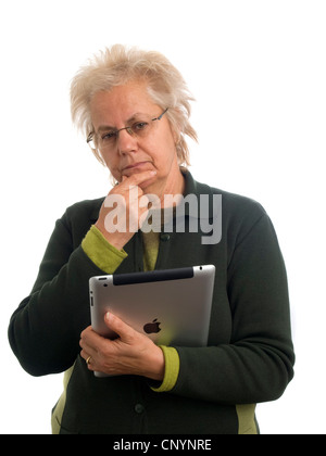 Mature woman holding iPad - Stock Photo