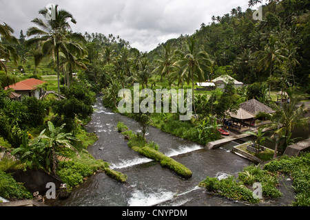 river flows down the flank of Gunung Agung, the highest mountain on the island , Indonesia, Bali - Stock Photo