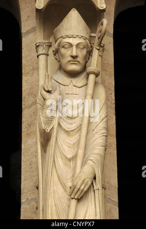 Gothic Art. France. Notre Dame. Saint Marcel on trumeau. Portal of St. Anne. 13th century. Paris. - Stock Photo