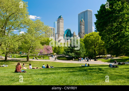 People relaxing in Central Park, New York City in spring season. - Stock Photo