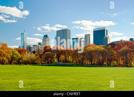 Central Park, New York City, in Autumn, looking towards the Central Park South skyline from Sheep Meadow. - Stock Photo