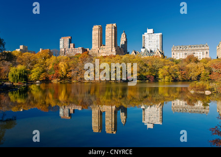 Central Park, New York City in Autumn at The Lake with Central Park West Skyline and the Dakota Apartments. - Stock Photo