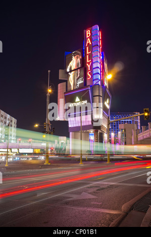 Long exposure street traffic scene with Ballys Hotel in background at Las Vegas Boulevard - Stock Photo