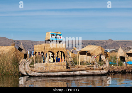 ship made of straw at one of 42 floating islands on Lake Titicaca called 'Uros Islands', self-built of totora reeds - Stock Photo